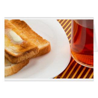 Cartes Pain grillé chaud avec du beurre et la tasse de