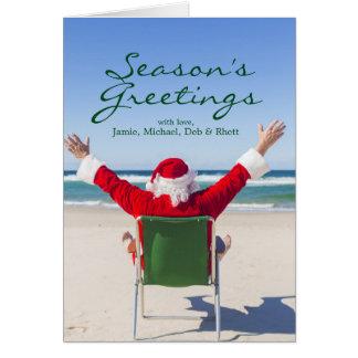 Cartes Père Noël détendant sur une plage australienne