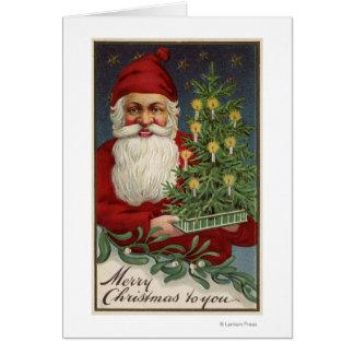 Cartes Père Noël tenant un arbre illuminé par des bougies