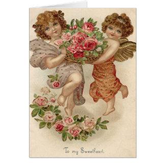 Cartes Rose de roses de panier d'ange d'ange de cupidon