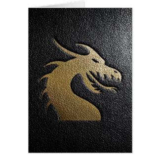 Cartes Silhouette d'or de dragon sur le cuir noir