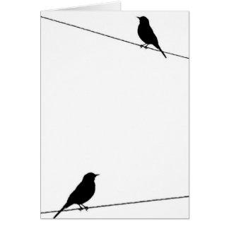 Cartes Silhouettes d'oiseau sur le fil