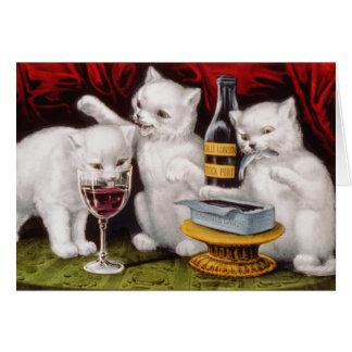 Cartes Trois chatons avec du vin et des sardines