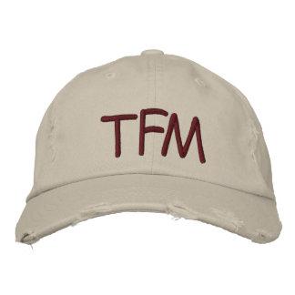 Casquette en lambeaux du fonctionnaire TFM
