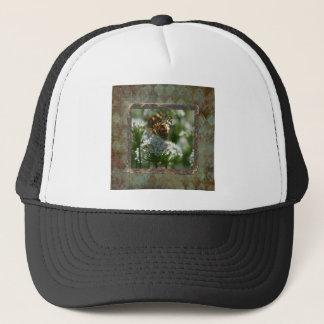 Casquette Mite de capitaine sur des fleurs de ciboulette,