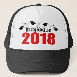 Casquettes et diplômes du diplômé 2018 d'école