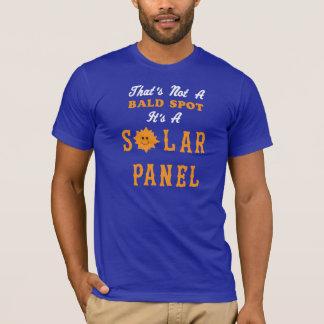 Ce n'est pas une tache chauve que c'est un panneau t-shirt