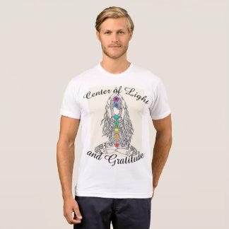 Centre de lumière et de T-shirt des hommes de