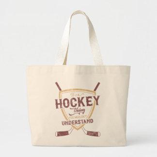 C'est un sac d'épicerie de chose d'hockey