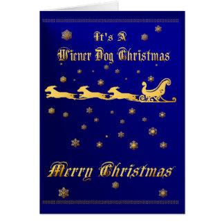 C'est une carte de Noël de chien de saucisse