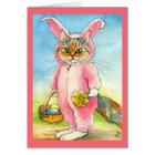 Chat dans une carte de Pâques de costume de lapin