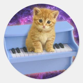Chat de piano sticker rond