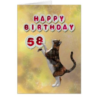 Chat espiègle et cinquante-huitième ballons de carte de vœux