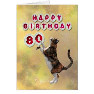 Chat espiègle et quatre-vingtième ballons de carte de vœux