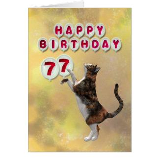 Chat espiègle et soixante-dix-septième ballons de carte de vœux