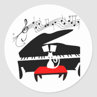 Chat et piano sticker rond