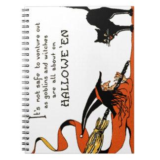 Chat noir de balai de sorcière carnets à spirale