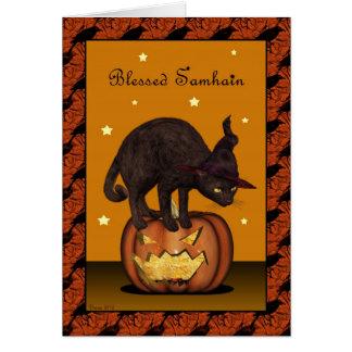 Chat noir sur la carte de voeux de Jack-o'-lantern