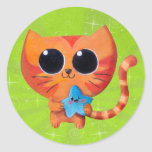 Chat orange mignon avec l'étoile sticker rond