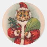Chat Père Noël par Louis Wain Adhésif Rond