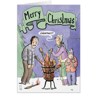 Châtaigne de guitare de carte de Noël sur un feu