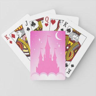 Château rêveur rose dans le ciel étoilé de lune de cartes à jouer