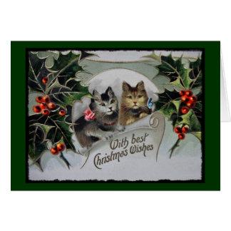 Chatons vintages de vacances portant des arcs carte de vœux