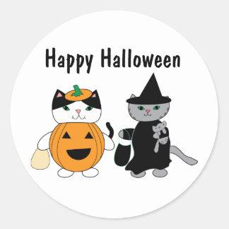 Chats de Halloween dans des costumes Sticker Rond