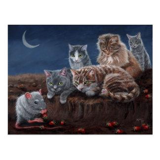 Chats et rat avec la carte postale de fraises