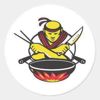 Chef et un wok sticker rond