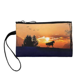 cheval courant - cheval de coucher du soleil - portefeuille
