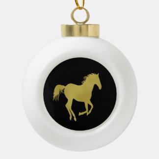 Cheval courant d'or sur le noir boule en céramique