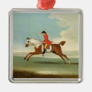 Cheval de course galopant et jockey monté en rouge ornement carré argenté