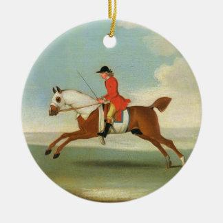 Cheval de course galopant et jockey monté en rouge ornement rond en céramique