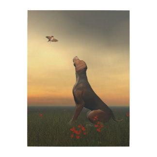 Chien bronzage de noir regardant un vol d'oiseau impressions sur bois