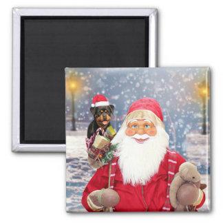 Chien de rottweiler de cadeaux de Noël du père Aimant