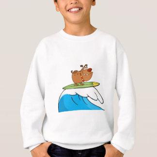 Chien heureux tout en surfant sweatshirt