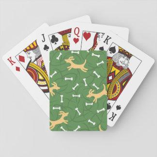 chiens chanceux avec l'arrière - plan d'os jeu de cartes