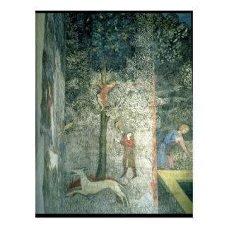 Chiens et hommes de chasse grimpant à un arbre carte postale