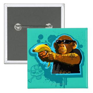 Chimpanzé tenant une banane badges