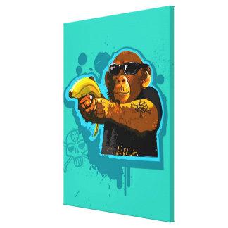 Chimpanzé tenant une banane toiles