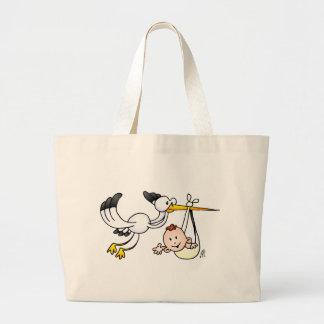 Cigogne avec le bébé grand sac