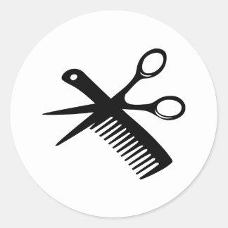 ciseaux noirs de peigne de coiffeur sticker rond