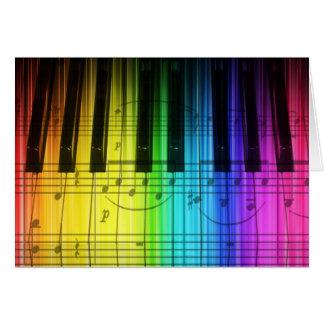 Clavier et notes de piano d'arc-en-ciel carte de vœux