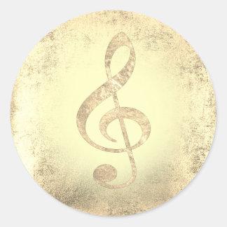 clef triple de musique d'or sticker rond