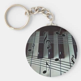 Clés de piano et notes de musique porte-clé rond