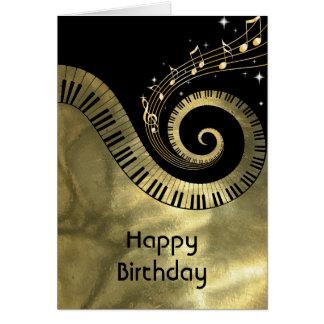 Clés de piano et notes imprimées de musique d'or carte de vœux