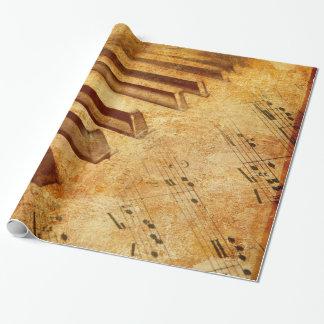 Clés grunges de piano de feuille de musique papier cadeau