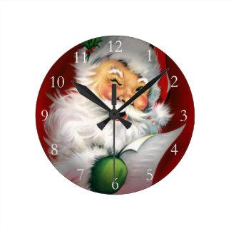 Cligner de l'oeil la liste de Noël de Père Noël Horloge Ronde