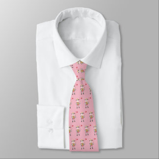 Cloche de neige dans la cravate de rose d'amour